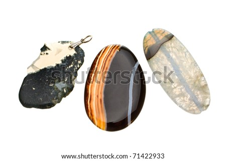 Ornamental stone of turquoise color on a white background - stock photo
