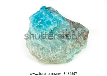 Ornamental stone of turquoise color on a white background
