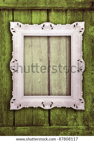 Ornamental white frame on an aged  wooden background, similar available in my portfolio - stock photo