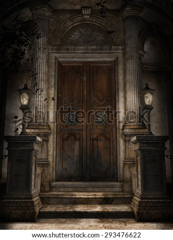 Ornamented door to a gothic cemetery crypt with lanterns