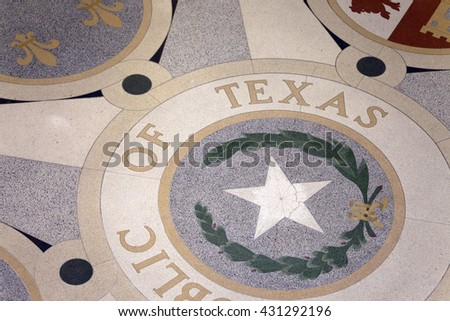 Ornamented marble floor with Republic of Texas state symbols - stock photo