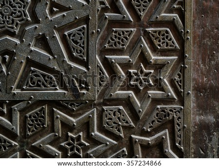 Ornaments of the bronze-plate door of an ancient historic mosque in Old Cairo, Egypt - stock photo