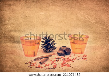 Ornaments with candles and pine cones on a grungy background - stock photo