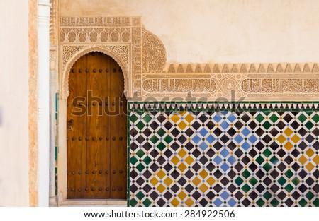 ornate arabic door in alhambra - stock photo