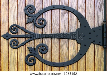 Ornate Brass Door Handles - Close-up on a Church entrance in rural Iowa - stock photo