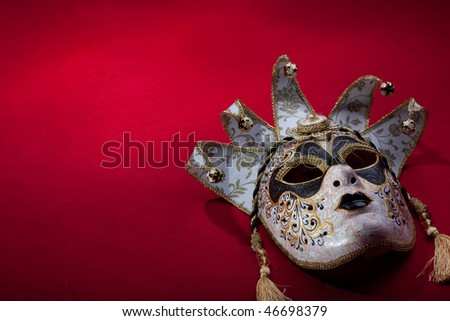 ornate carnival mask over red background - stock photo