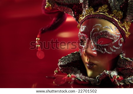 ornate carnival mask over textured metalic background - stock photo