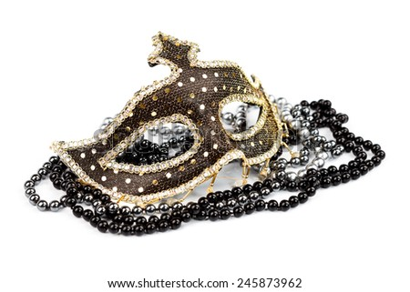 Ornate carnival mask with black and silver pearls, white background - stock photo