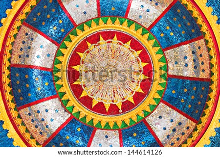 Ornate ceiling with chandelier in the temple - stock photo