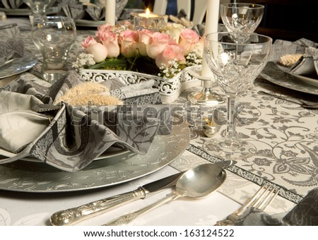 Ornate christmas dinner table with decorated napkins - stock photo