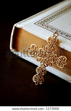 ornate cross and Bible - stock photo