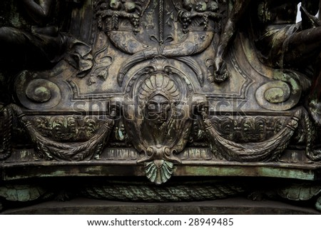 ornate detail in statue close-up - stock photo