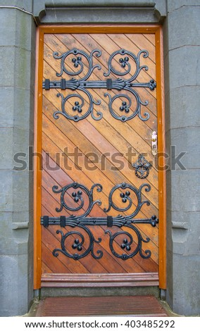 Ornate doors on a Roman Catholic Church At Cobh Cathedral in Cork, Ireland.