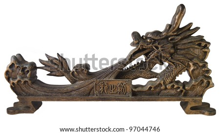 Ornate dragon sculpture isolated on white - stock photo