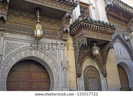 Ornate entrance to the historic Kairaouin Mosque deep inside the medina of Fes in Morocco. - stock photo
