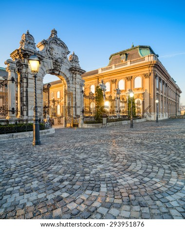 Ornate gates into Buda Castle in Budapest early in the morning. Focus on the gate. - stock photo