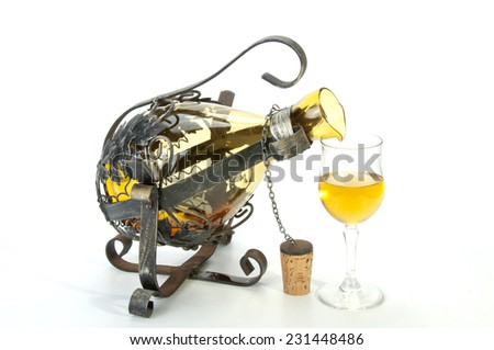 ornate metal decanter holder and wine glass - stock photo