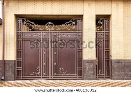 ornate metal gates in the design of granite - stock photo