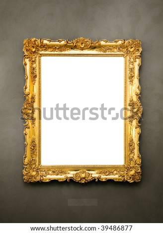 Ornate picture frame hanging on a wall - stock photo