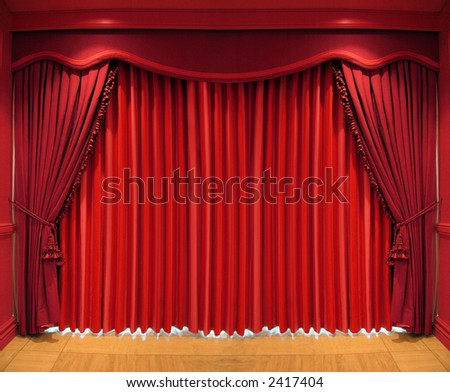 Ornate red curtains covering the whole window - stock photo