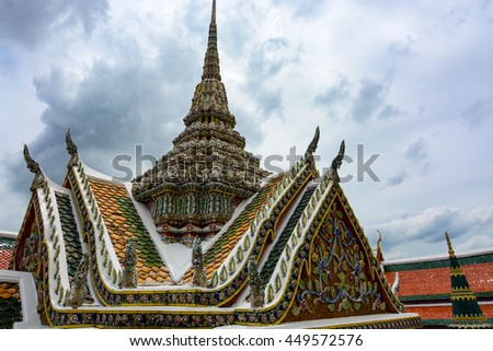 Ornate roof and spire at the historic Grand Palace in Bangkok, Thailand