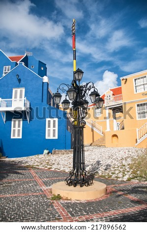 Ornate street lamp with multiple lights in a cobbled square in Willemstad in the Netherlands Antilles - stock photo