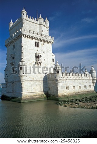 Ornate white stonework of Torre De Belem, a fort on the river in Lisbon, Portugal