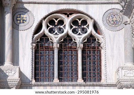 Ornate windows and columns detail on facade of Basilica di San Marco in Venice, Italy.  - stock photo