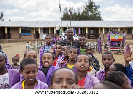 OROMIA, ETHIOPIA-APRIL 21, 2015: Unidentified headmaster at a school in rural Ethiopia stands with his students.