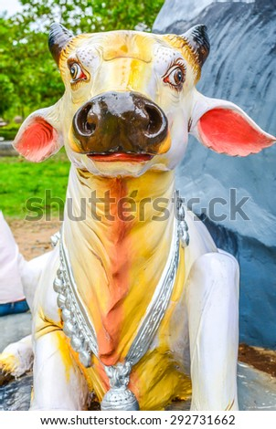 ORRISA, INDIA - APRIL 26, 2015: Holy cow statue in temple premesis in Orrisa, India
