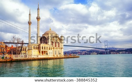 Ortakoy mosque and Bosphorus Bridge connecting Europe and Asia continents, Istanbul, Turkey - stock photo