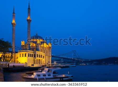 Ortakoy Mosque in night lights, in the background the bridge over the Bosphorus, Istanbul - stock photo