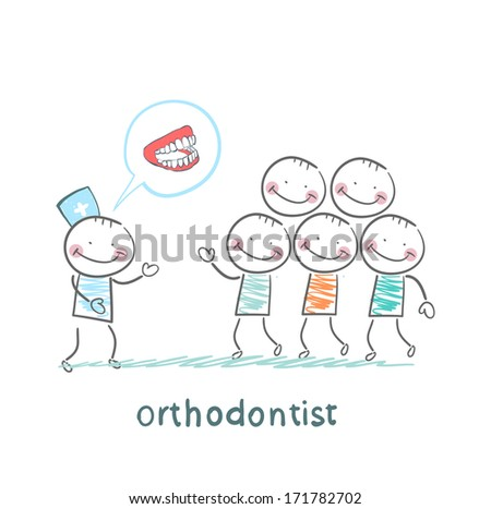 orthodontist says with patients about their teeth - stock photo