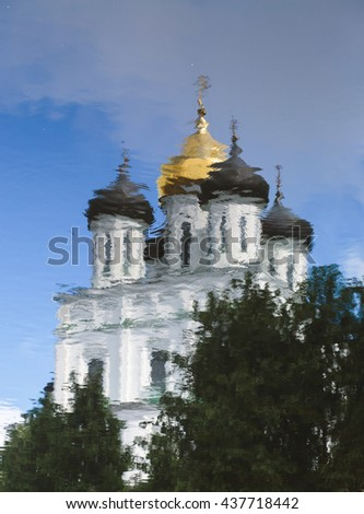 Orthodox cathedral church with golden dome reflected in water - stock photo