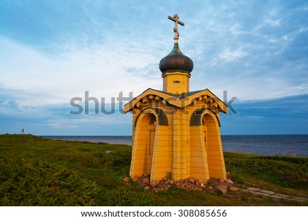 Orthodox chapel on the shore of the sea - stock photo