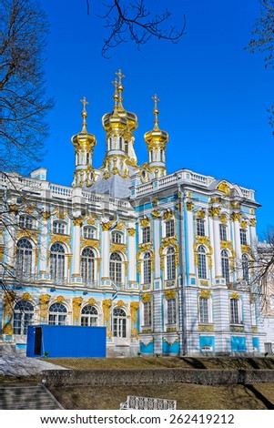 Orthodox Church of the Resurrection with golden domes of Catherine Palace in Tsarskoe Selo (Pushkin), St. Petersburg, Russia. - stock photo