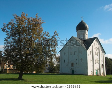 Orthodox church of twelfth century in Novgorod, Russia and a tree - stock photo