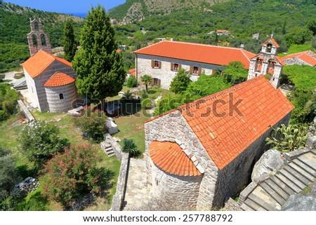 Orthodox monastery complex located in the Adriatic sea area, Montenegro - stock photo