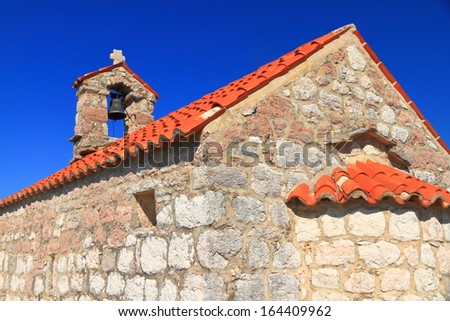 Orthodox monastery near the Adriatic sea in sunny day - stock photo