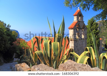 Orthodox monastery surrounded by Mediterranean vegetation near the Adriatic sea - stock photo