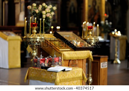 Orthodox wedding accessories including two crown and Holy Bible - stock photo