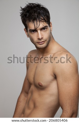 ortrait of an attractive muscular build man - stock photo