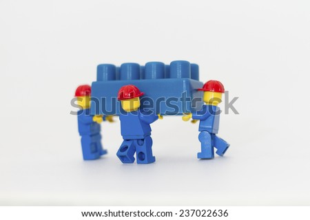 Orvieto, Italy - December 10th 2014: Lego mini figure workman at work on white background. Lego is a popular line of construction toys manufactured by the Lego Group - stock photo