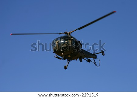 Oryx helicopter full frame on a clear day with bright blue background - stock photo