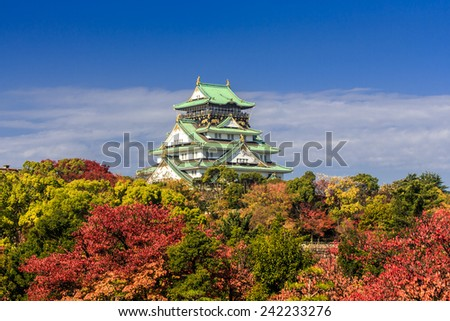 Osaka Castle during autumn under a beautiful blue sky, Japan - stock photo