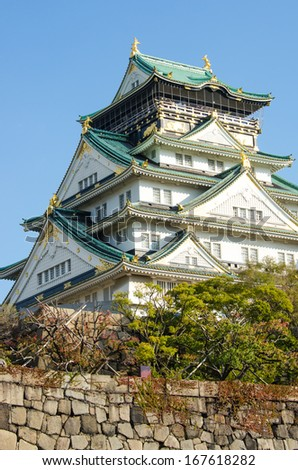 Osaka castle in clear fine day in Autumn, Japan - stock photo