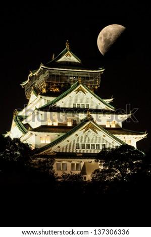 Osaka castle with moon - stock photo