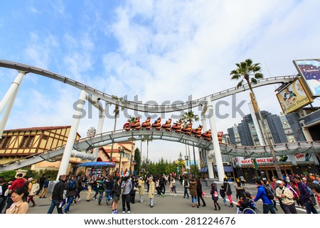 Osaka, Japan - Apr 9: Riders enjoy the Rip Ride Rockit Rollercoaster at Universal Studios Theme Park in Osaka, Japan on Apr 9, 2015. The theme park has many attractions based on the film industry. - stock photo