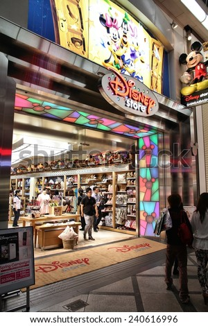 OSAKA, JAPAN - APRIL 24, 2012: Customers visit Disney Store in Osaka, Japan. Disney Stores is a retail company founded 1987. It has 360 stores in prestigious locations.