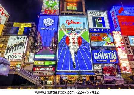 OSAKA,JAPAN - 18 April,2014 :Dotonbori is a popular nightlife and entertainment area characterized by its eccentric atmosphere and large illuminated signboards. - stock photo